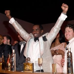 kanye west and jay z shake hands at diddy 50th birthday party